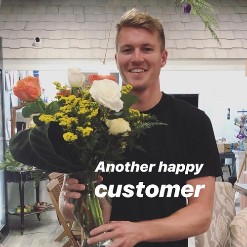 happy customer buying flowers for his sweetheart